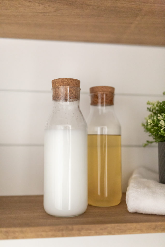 Laundry room makeover - I used Carafe bottles with cork lid from Ikea for my softener and washing detergent liquid.
