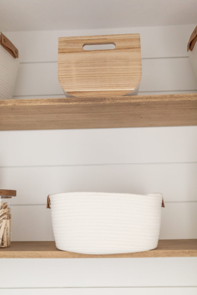 Laundry room makeover - A close up of the Paulownia Wood Bin and the small Coiled Rope basket from Target.