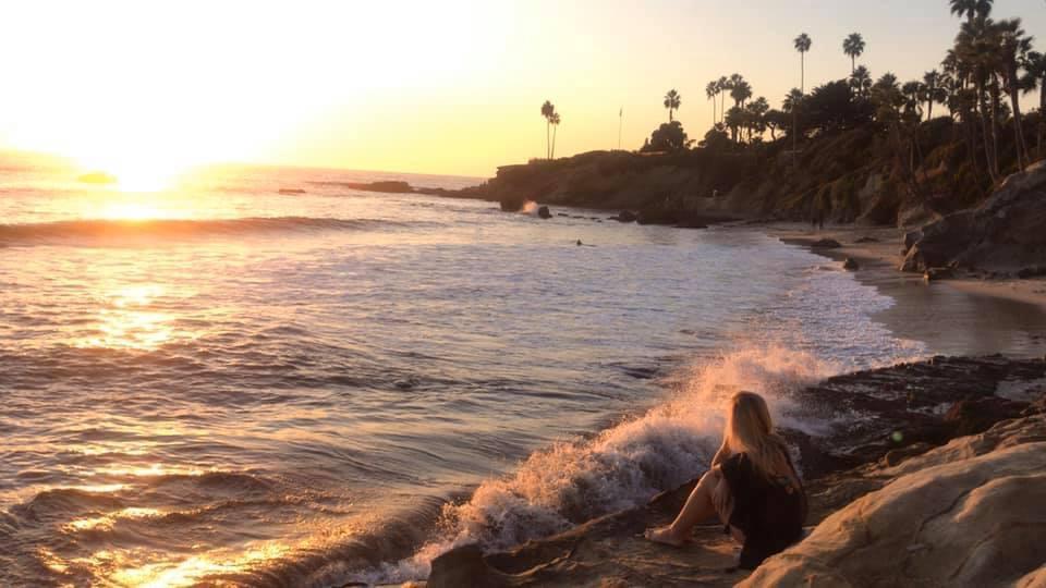 Waves crashing in Laguna Beach during sunset
