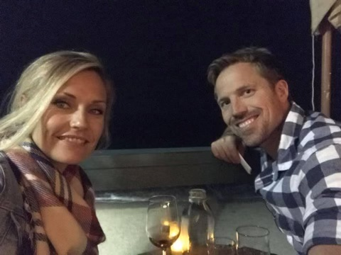 My and my hubby on the deck of Driftwood Kitchen.