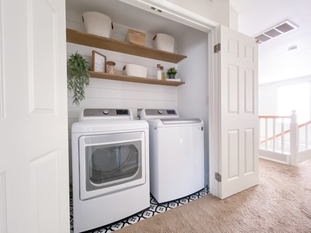 Laundry room makeover - Pull back view of Laundry room update with Target organizational storage bins.