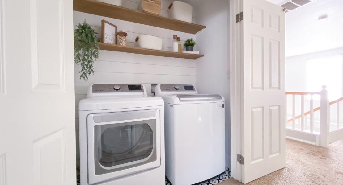 Extended view of Laundry room update with Target organizational storage bins.