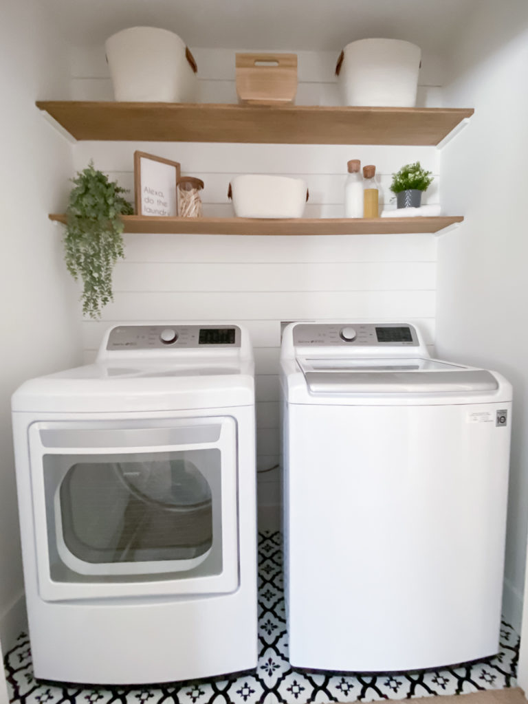 A laundry room makeover with Shiplap, poplar wood shelves, and trending storage baskets