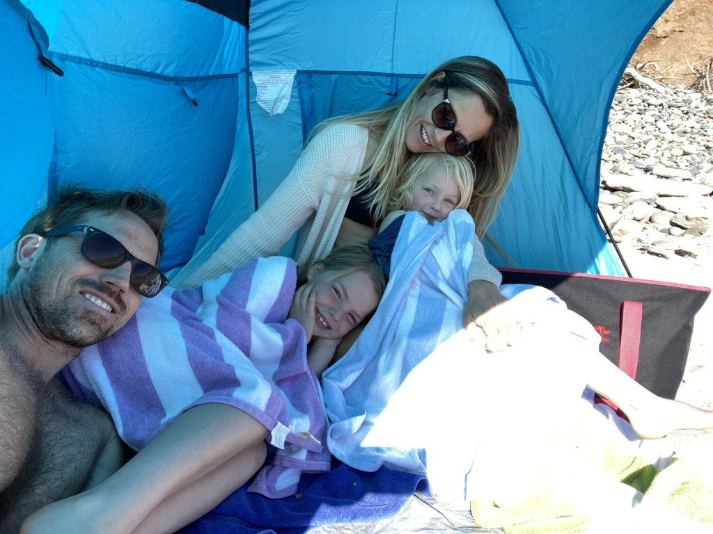 Relaxing with the family under the beach tent
