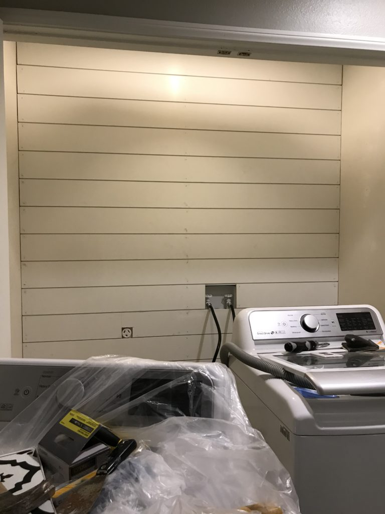 MDF primed shiplap installed and ready for filler and paint.
