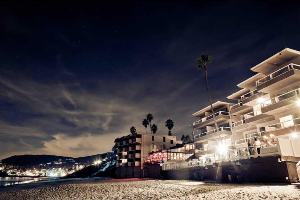 Nighttime view of Pacific Edge Hotel and Driftwood Kitchen in Laguna Beach