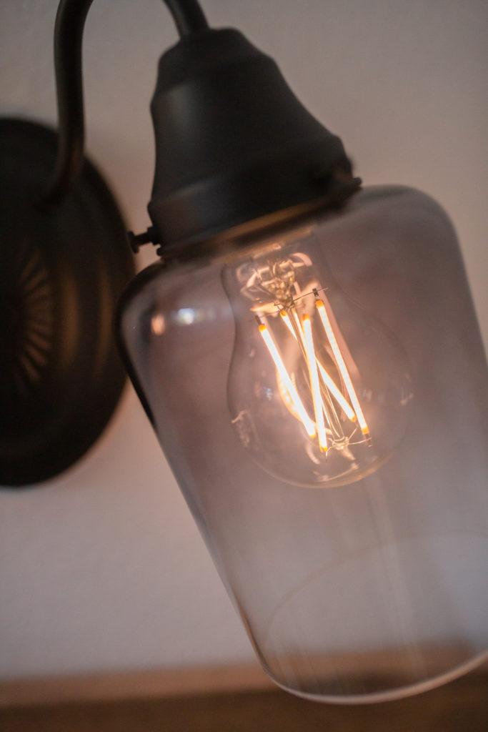 Bathroom makeover - Closeup of new bulb in Vanity light fixture