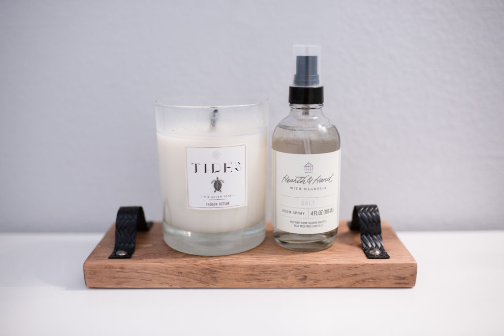 Bathroom makeover - View of DIY wood tray with Candle and room spray on it.