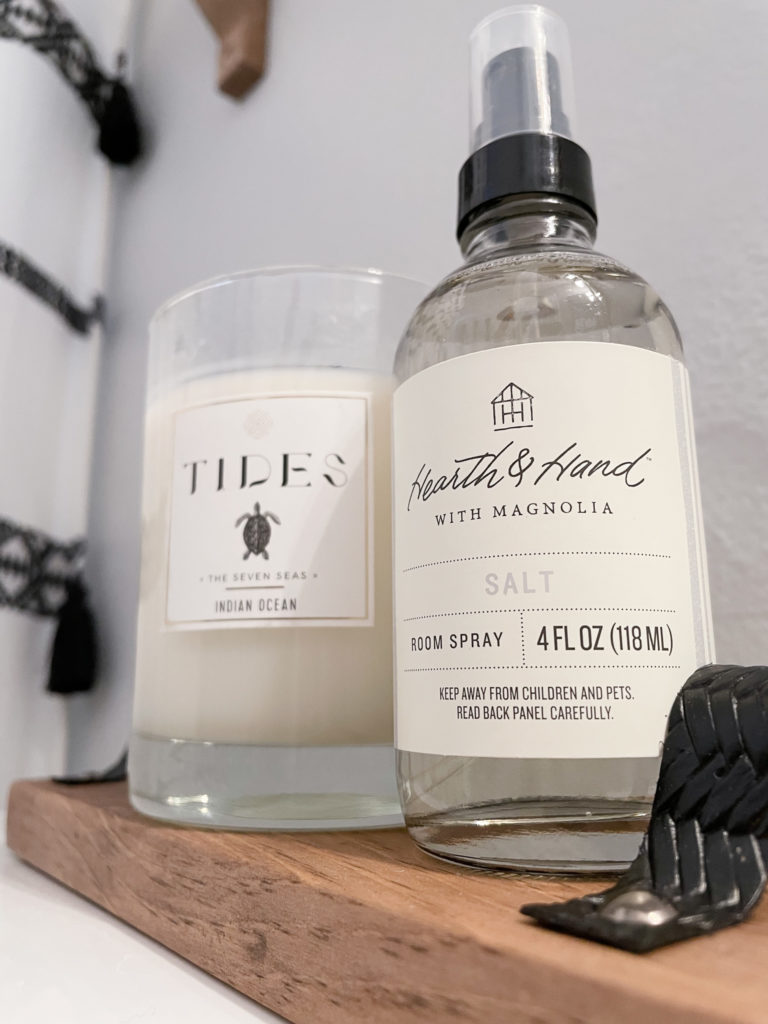 Closeup of the tray with the TIDES candle that smells the best! And Hearth & Hand room spray in Salt scent from Target.