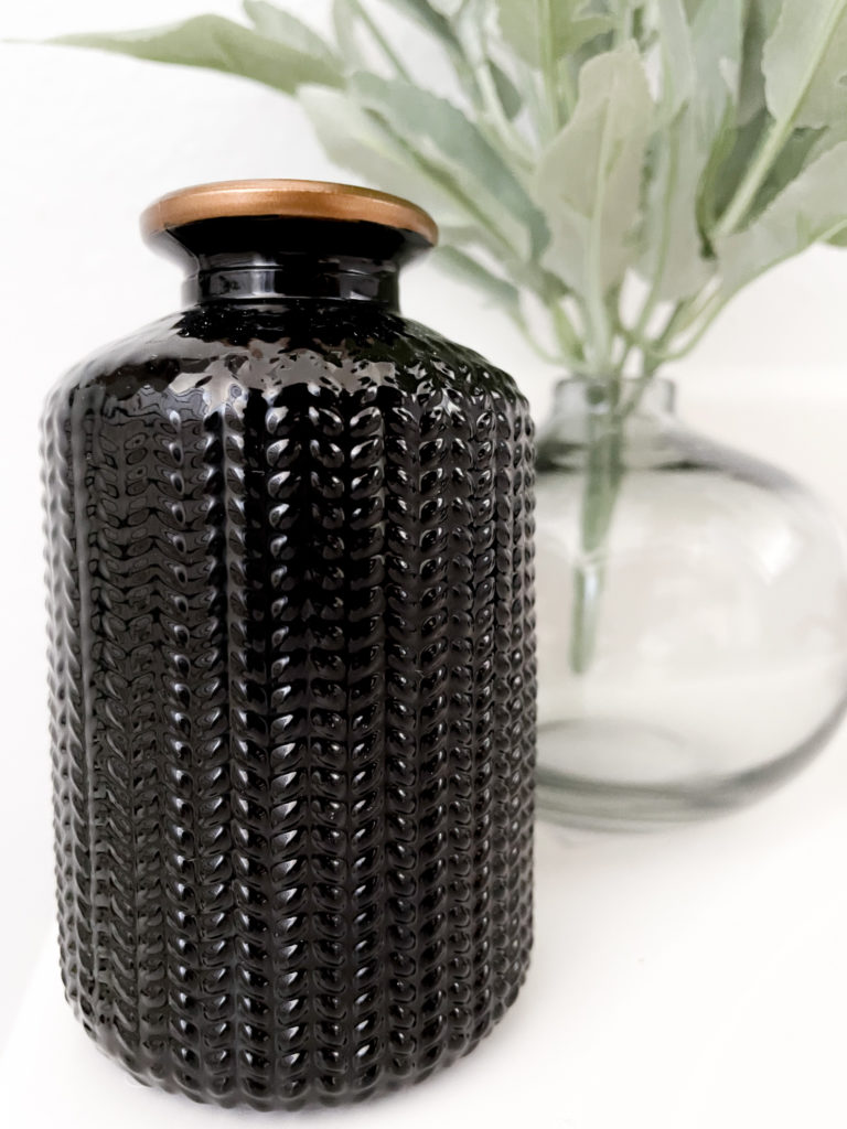 Bathroom makeover - Textured black and gold glass bottle from hobby lobby