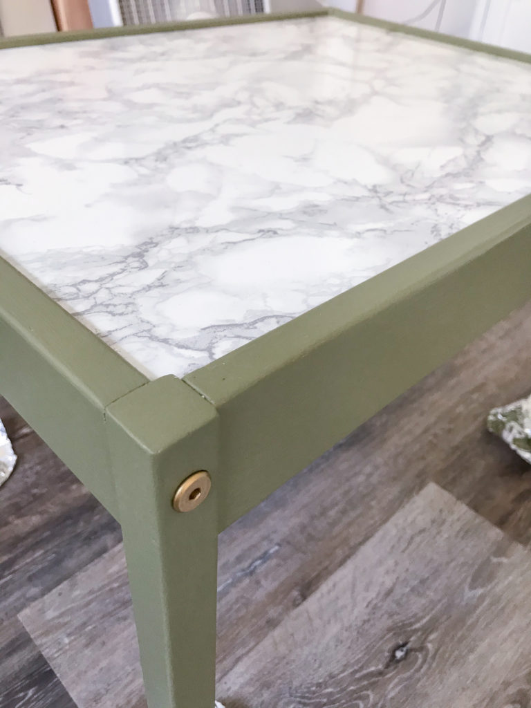 Ikea table with 'Olive Grove' by BM paint and marble contact paper tabletop.