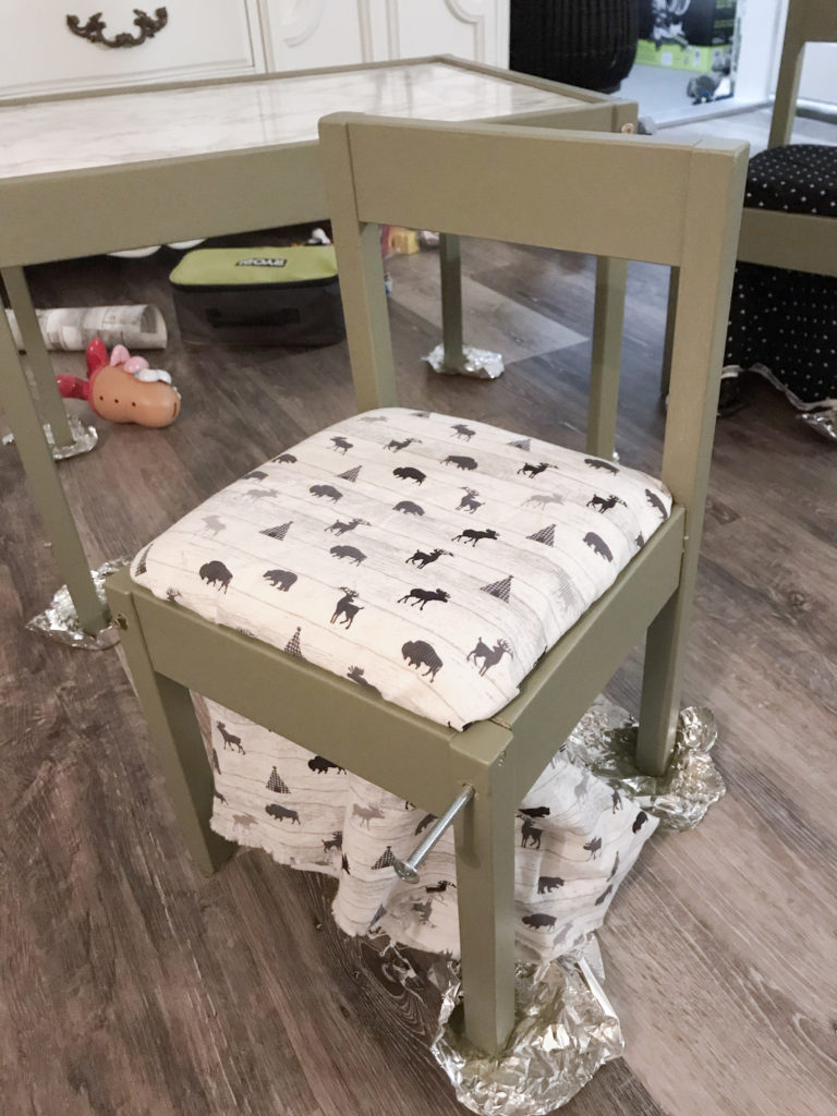 Ikea LATT chair hack with 'Olive Grove' by BM paint and white 'woodland animal' fabric cushions.