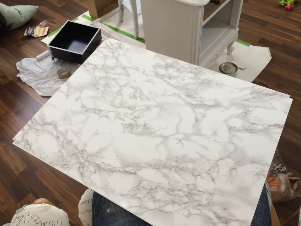 Covered the tabletop with marble con-tact paper