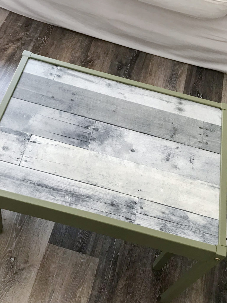 Ikea LATT table with 'Olive Grove' by BM paint and 'wood' wallpaper tabletop.