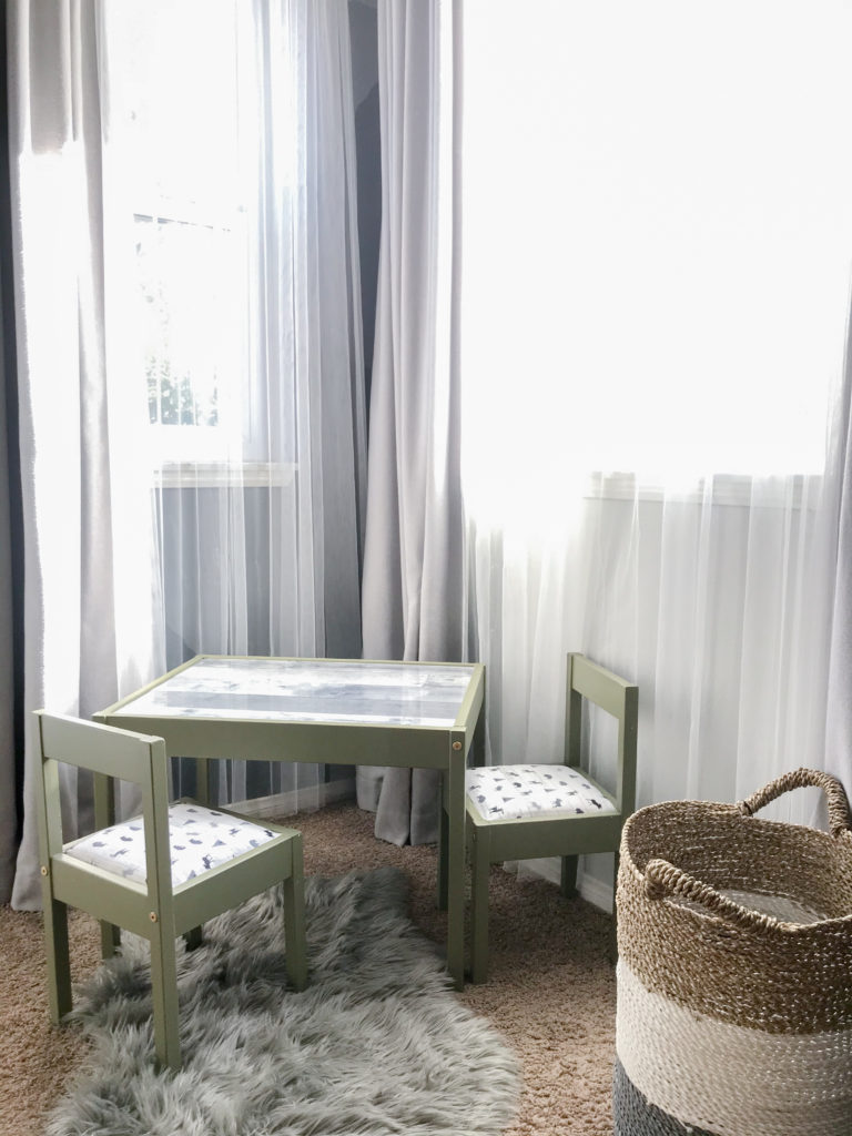 Ikea LATT table and chair hack for boys room with 'Olive Grove' by BM paint, white 'woodland animal' fabric cushions, and 'wood' wallpaper tabletop.