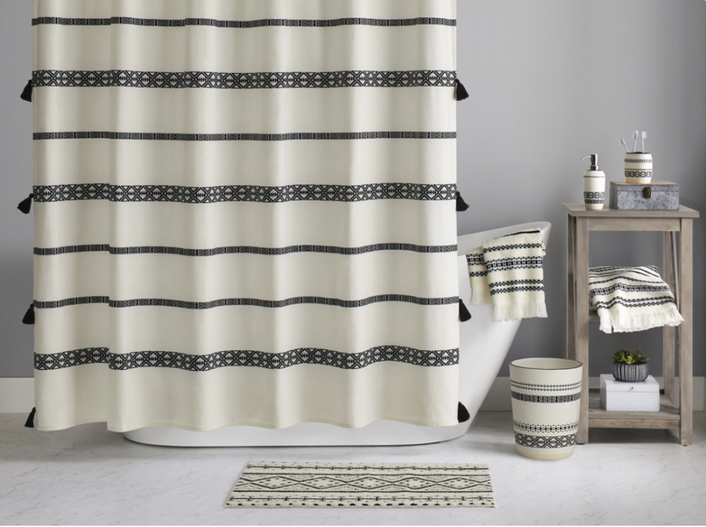 White and black patterned shower curtain from walmart.
