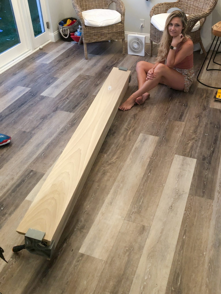 Building a poplar wood mantle with the help of 90 degree angles.