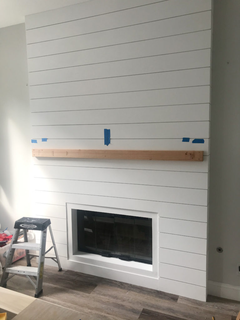 Secured a cleat to the shiplap to hold up the mantle. Screwed three screws in the top to make it super sturdy.