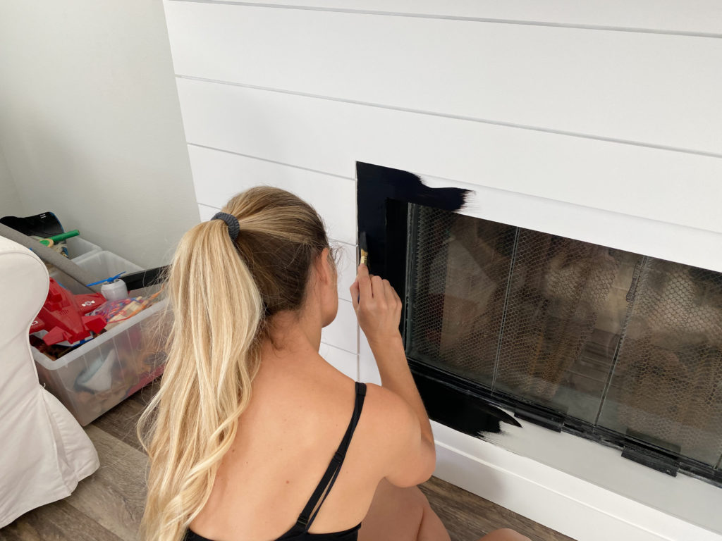 Painting the frame and ledge with Rustoleum painters touch flat black so it can disappear into the shadow and create the illusion of the fireplace being flush with the shiplap.