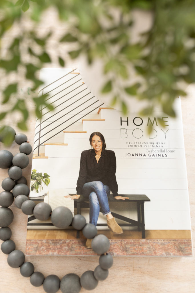 Closeup of the coffee table book, none other than 'Home Body' by Joanna Gaines